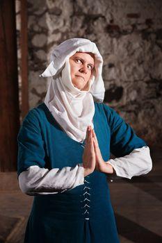 Sinister Nun in Prayer
