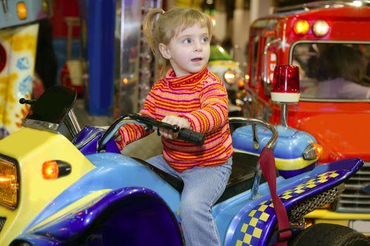 blond little girl in funfair fairground attraction