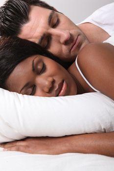 Mixed-race couple asleep