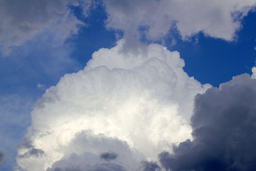 cumulus clouds dramatic blue sky cloudy