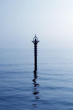 backlight beacon in Mediterranean blue sea reflection