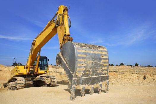 excavator yellow vehicle on sand quarry