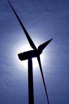 aerogenerator windmill backlight blue sky