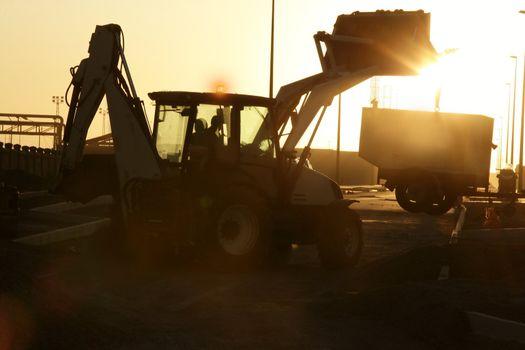 Bulldozer excavator backlight evening sunset
