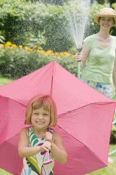 Summer water fun with garden hose rain