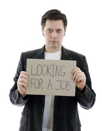 Unemployed businessman with a sign LOOKING FOR A JOB. Isolated on white.