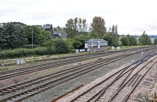 railway in scotland. small house of a lineman in background