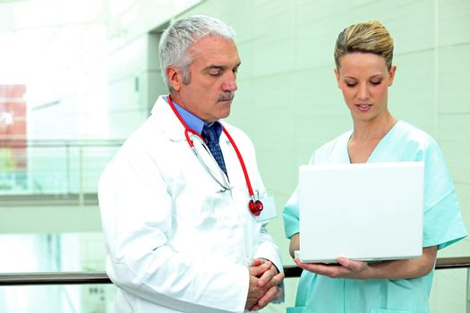doctor and nurse with computer