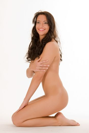 laughing beauty sitting naked on the floor with undercover act
