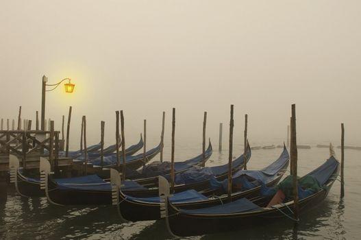 empty Venetian gondolas moored.Evening in Venice