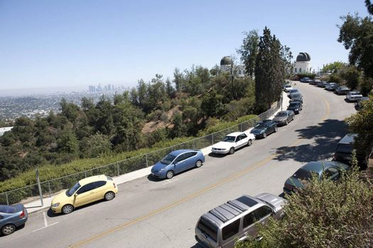 Streets full of cars near Griffith Observatory on a busy Saturday afternoon.
