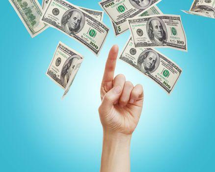 Hand with hundred dollar bills