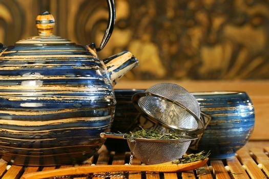 Blue Japanese teapot with strainer and green tea