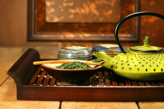 Cast iron teapot ready to make a warm cup of green tea