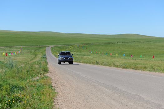 SUV moving in Hulun Buir grassland of Inner-Mongolia, China