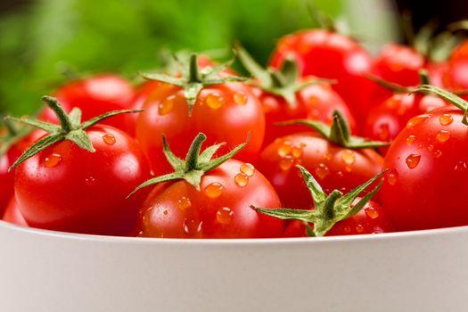Tomatoes inside white bowl