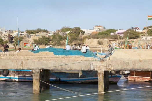 Fishermens nets being mended at Bet Dwarka