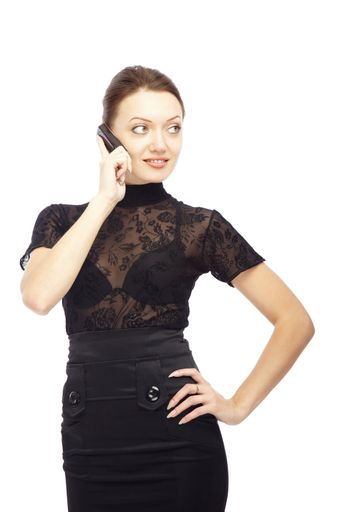 Smiling lady talking via cell phone and making hand akimbo on a white background