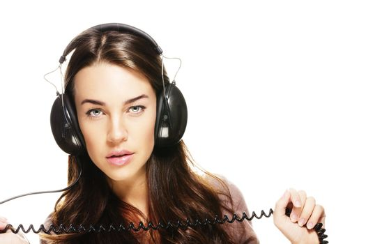 beautiful woman with headphones holding cord