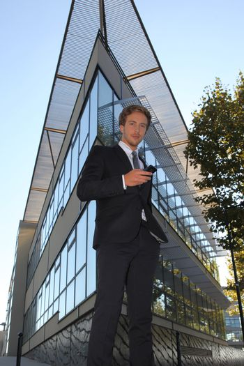 executive in front of triangular building