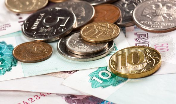 A heap of coins and banknotes