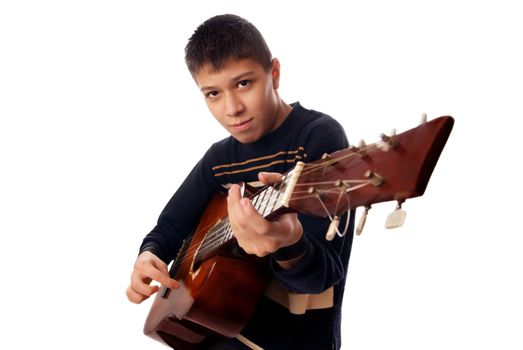 Studio photo of young boy playng guitare
