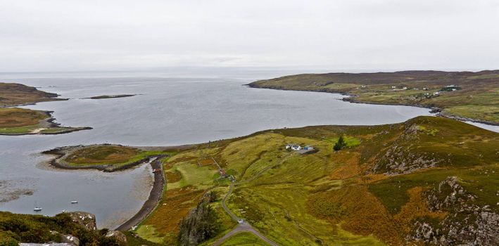 coast in scotland with smooth hills and bushes