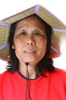 A 50s asian woman wearing hat