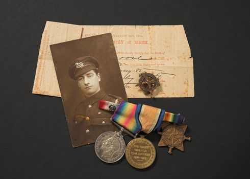 Great War memorabilia - photograph medals and birth certificate