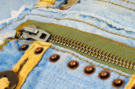 Zipper on the pocket of jeans. Macro photo.