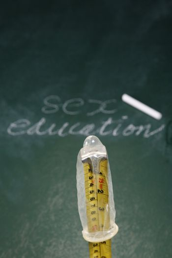stock image of the condom in front of blackboard