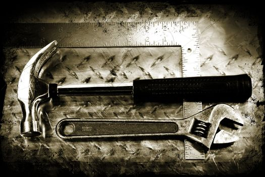 Work tools on a grunge metal background