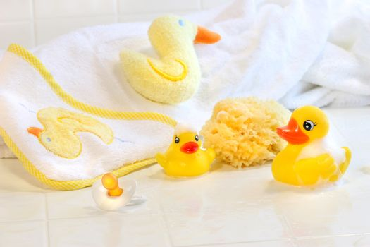 Bathtime for baby with toys and towel
