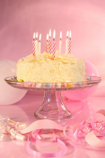 Birthday cake  with candles and assorted ribbons