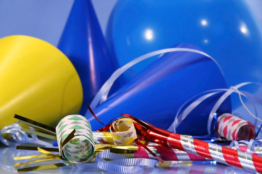 Blue party decorations with balloons,hats and ribbons