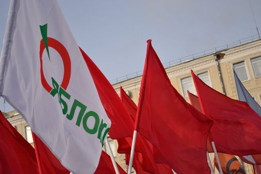 White flag of Russian democratic party over red flags of russian communists
