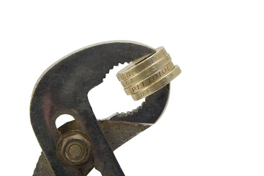 Coins clamped firmly in a vice.