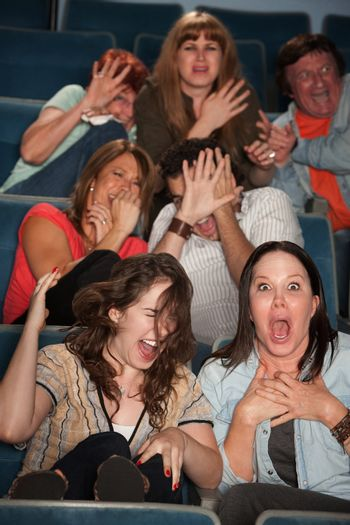 Frightened People in a Theater