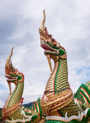 Two goldern Nagas that huge and shiny