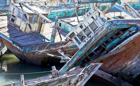 Dwarka Roadtrip. Boat graveyard in Gujarat India of wooden shipping that has been shipwrecked or taken out of service