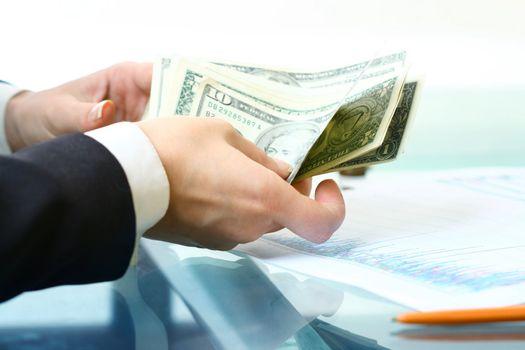 hands hold money