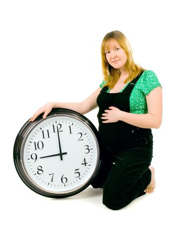 pregnant woman with a clock