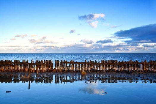 old wooden breakwater in North sea