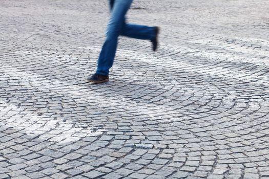 man running at a pedestrian crossing