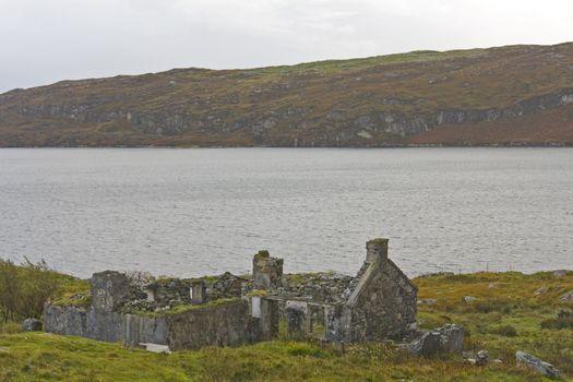 abandoned, ruined house at scottish coastline