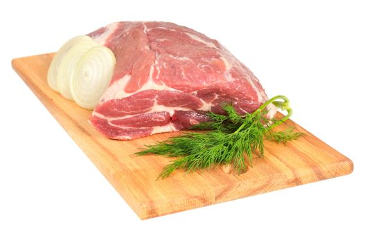 Piece of pork for roasting on a wooden board. Isolated on white.