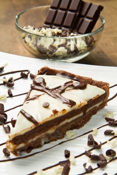 white dish with chocolate cake