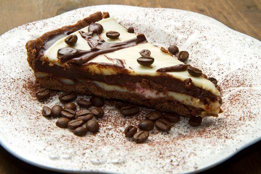 white dish with coffee cake