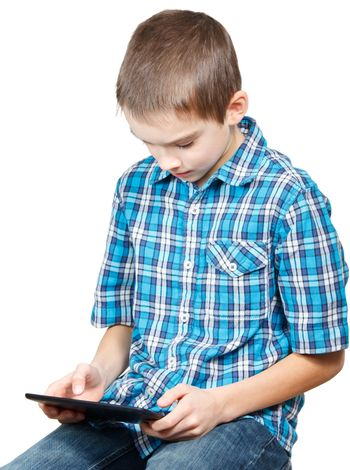 Kid playing with a tablet computer