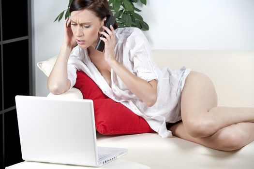 Woman in casual wear expressing concern on the phone